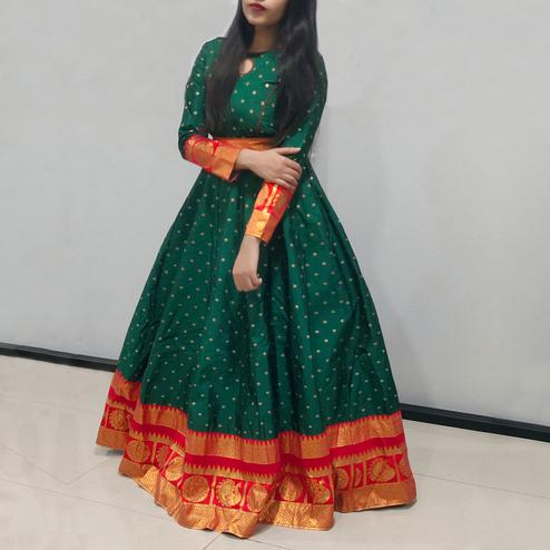 Graceful Green Colored Festive Wear Woven Tapetta Silk Gown