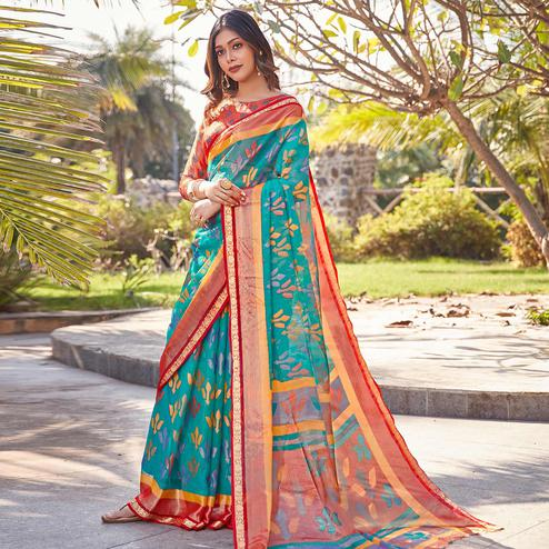 Flirty Turquoise Blue Colored Festive Wear Woven Chiffon Brasso Saree