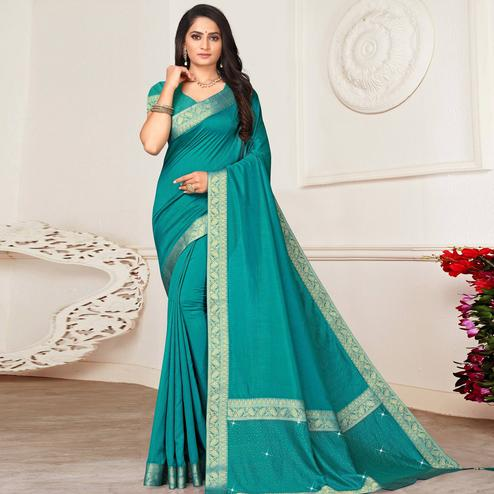 Adorning Turquoise Blue Colored Festive Wear Lace Work Vichitra Silk Saree