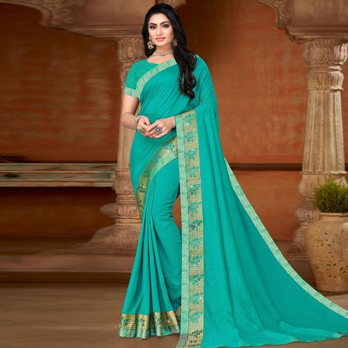 Amazing Turquoise Blue Colored Festive Wear Lace Work Vichitra Silk Saree