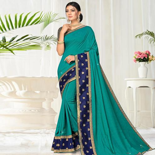Arresting Turquoise Green Colored Festive Wear Lace Work Vichitra Silk Saree