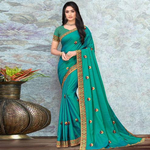 Pleasant Turquoise Green Colored Festive Wear Lace Work Vichitra Silk Saree
