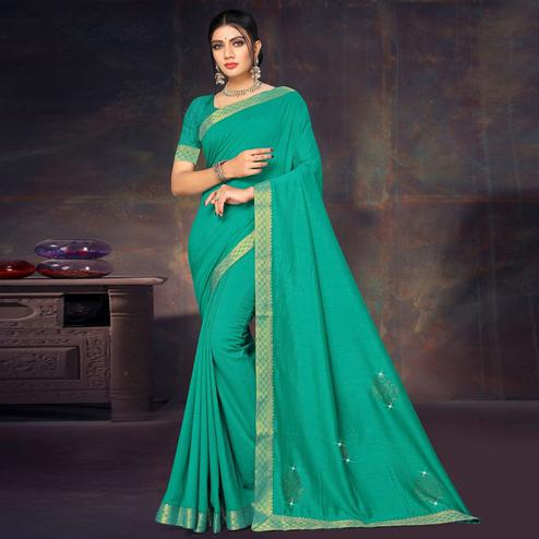 Flamboyant Green Colored Festive Wear Lace Work Vichitra Silk Saree