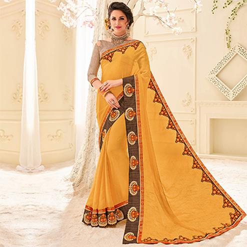 Orange Colored Designer Embroidered Taspa Saree