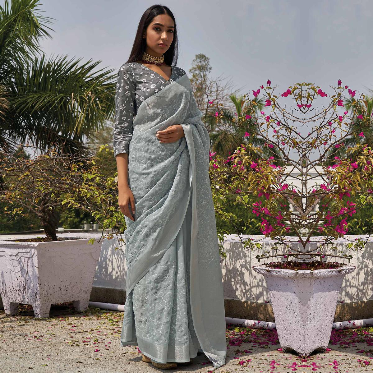 Blooming Grey Colored Partywear Embroidered Fancy Linen Saree