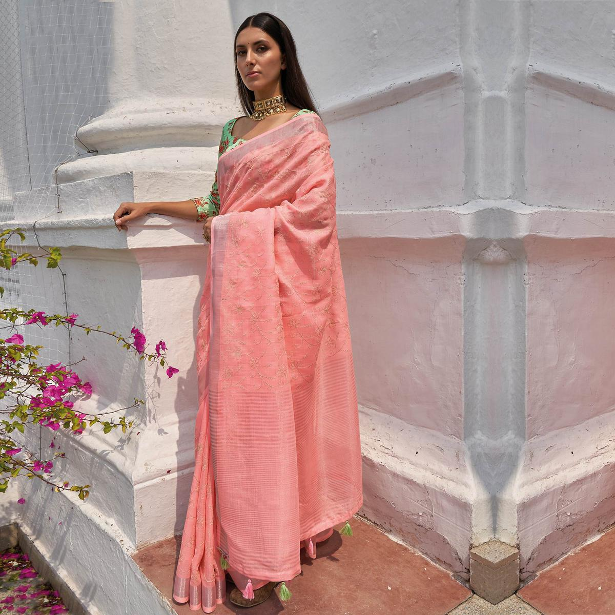 Charming Peach Colored Partywear Embroidered Fancy Linen Saree