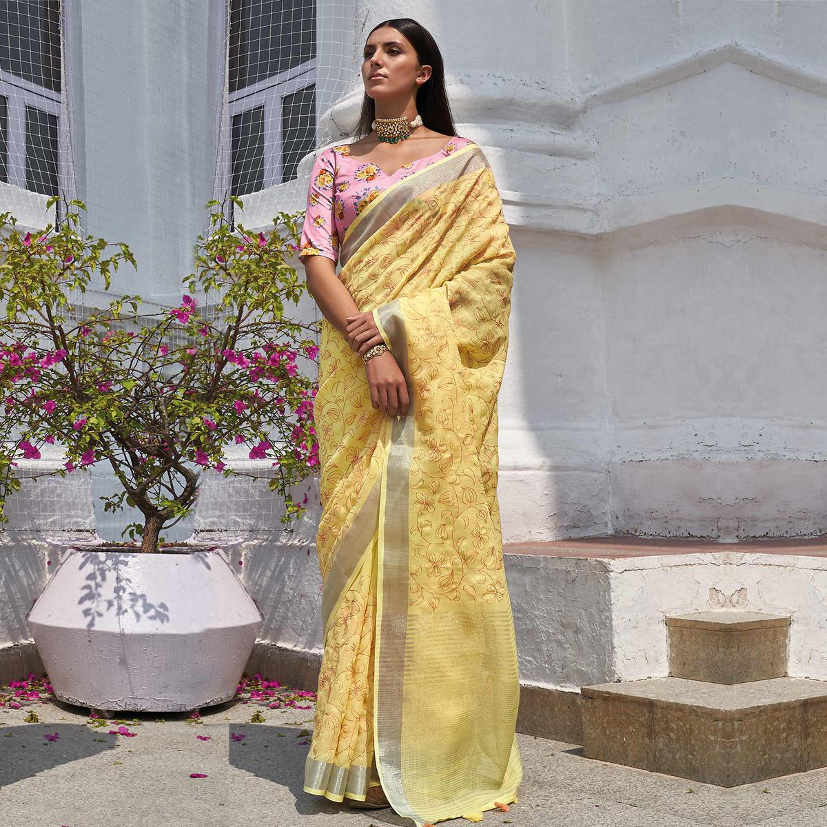 Jazzy Yellow Colored Partywear Embroidered Fancy Linen Saree