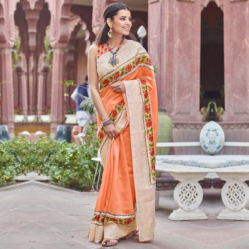 Amazing Orange Colored Partywear Embroidered Silk Saree