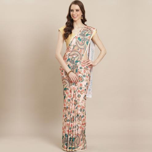 Charming Pastel Peach Colored Casual Wear Printed Crepe Saree