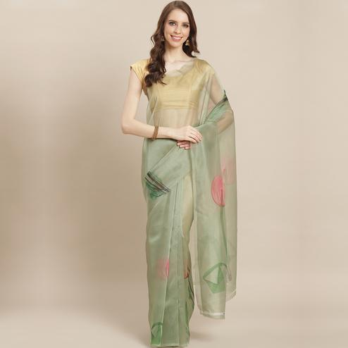 Eye-catching Pastel Green Colored Casual Wear Printed Organza Saree