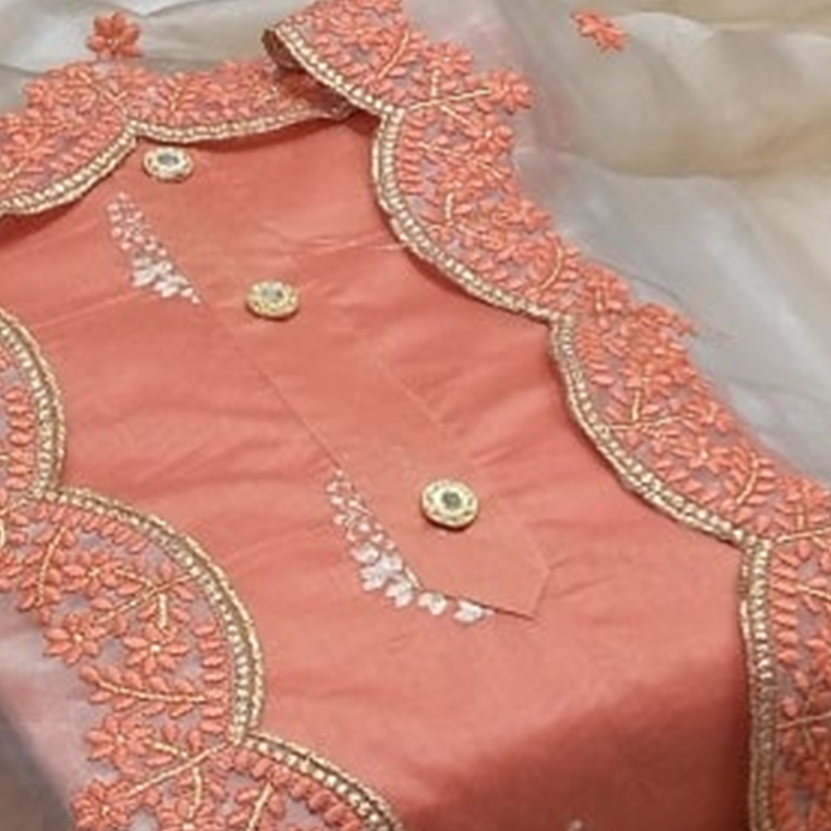 Intricate Peach Colored Festive Wear Embroidered Chanderi Cotton Dress Material