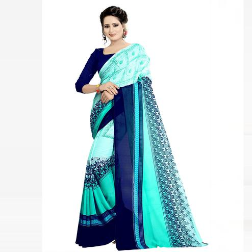 Swara Enterprise - Light Blue Poly Georgette Screen Print Saree With Blouse