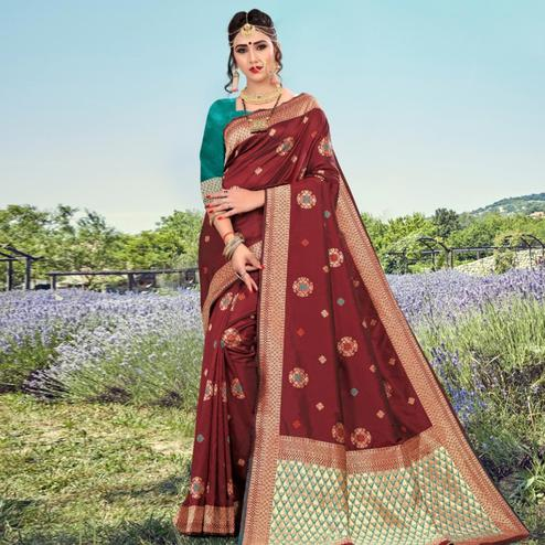 Exotic Maroon Colored Festive Wear Woven Lichi Silk Saree