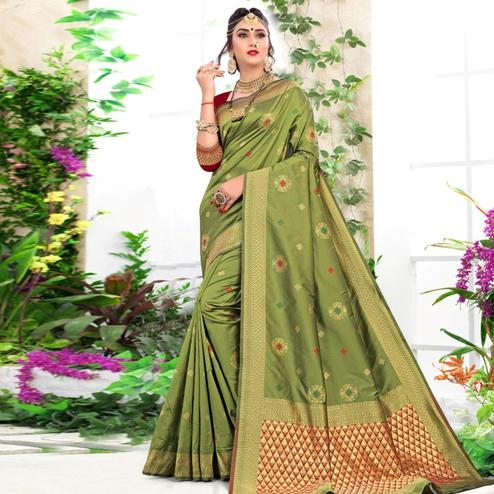 Sophisticated Green Colored Festive Wear Woven Lichi Silk Saree