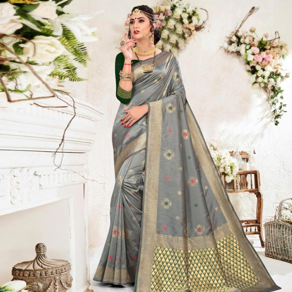 Pleasant Grey Colored Festive Wear Woven Lichi Silk Saree