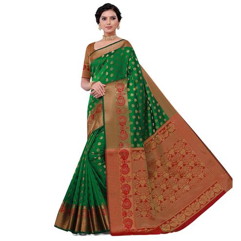 Intricate Dark Green Colored Festive Wear Woven Kota Art Silk Banarasi Saree