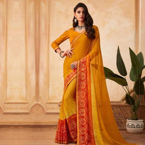 Attractive Yellow Colored Partywear Printed Georgette Saree