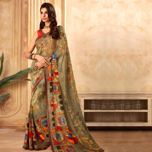 Beautiful Olive Green Colored Partywear Printed Georgette Saree