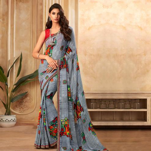 Eye-catching Grey Colored Partywear Printed Georgette Saree
