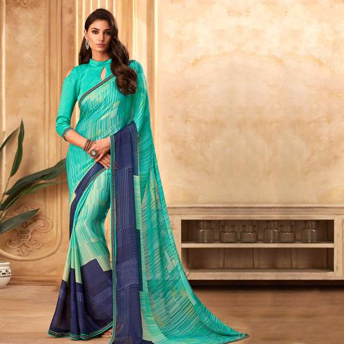 Gorgeous Turquoise Blue Colored Partywear Printed Georgette Saree