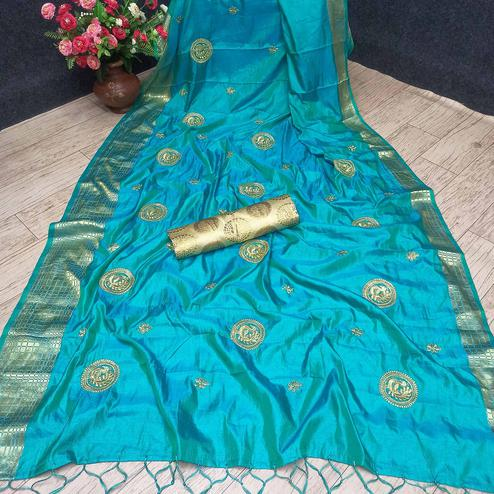 Flattering Turquoise Blue Colored Festive Wear Woven Banarasi Silk Saree With Tassels