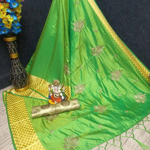 Pretty Green Colored Festive Wear Woven Banarasi Silk Saree With Tassels
