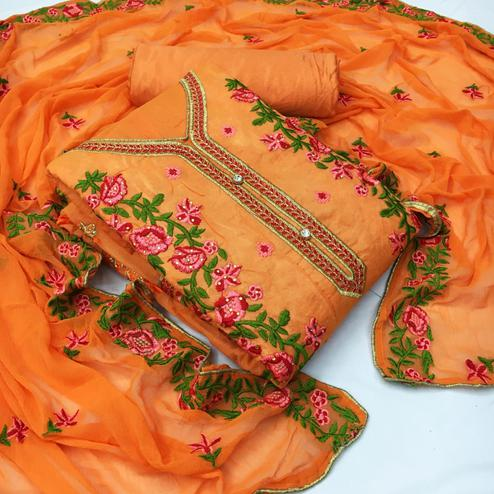 Attractive Orange Colored Partywear Floral Embroidered Chanderi Dress Material