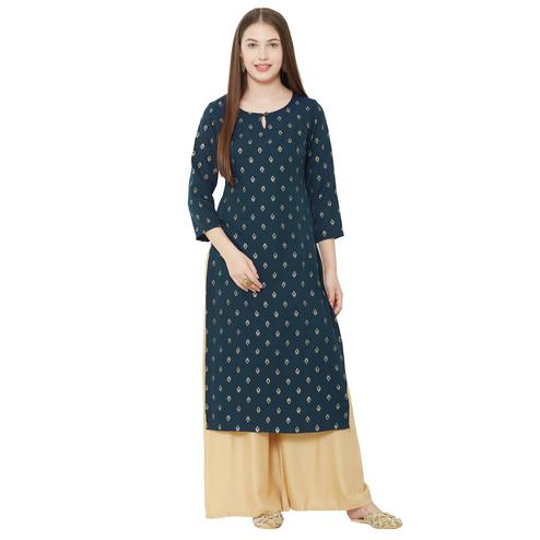 Glowing Teal Blue Colored Casual Wear Foil Printed Poly Crepe Kurti