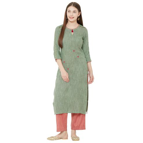 Gleaming Green Colored Casual Wear Embellished Cotton Kurti