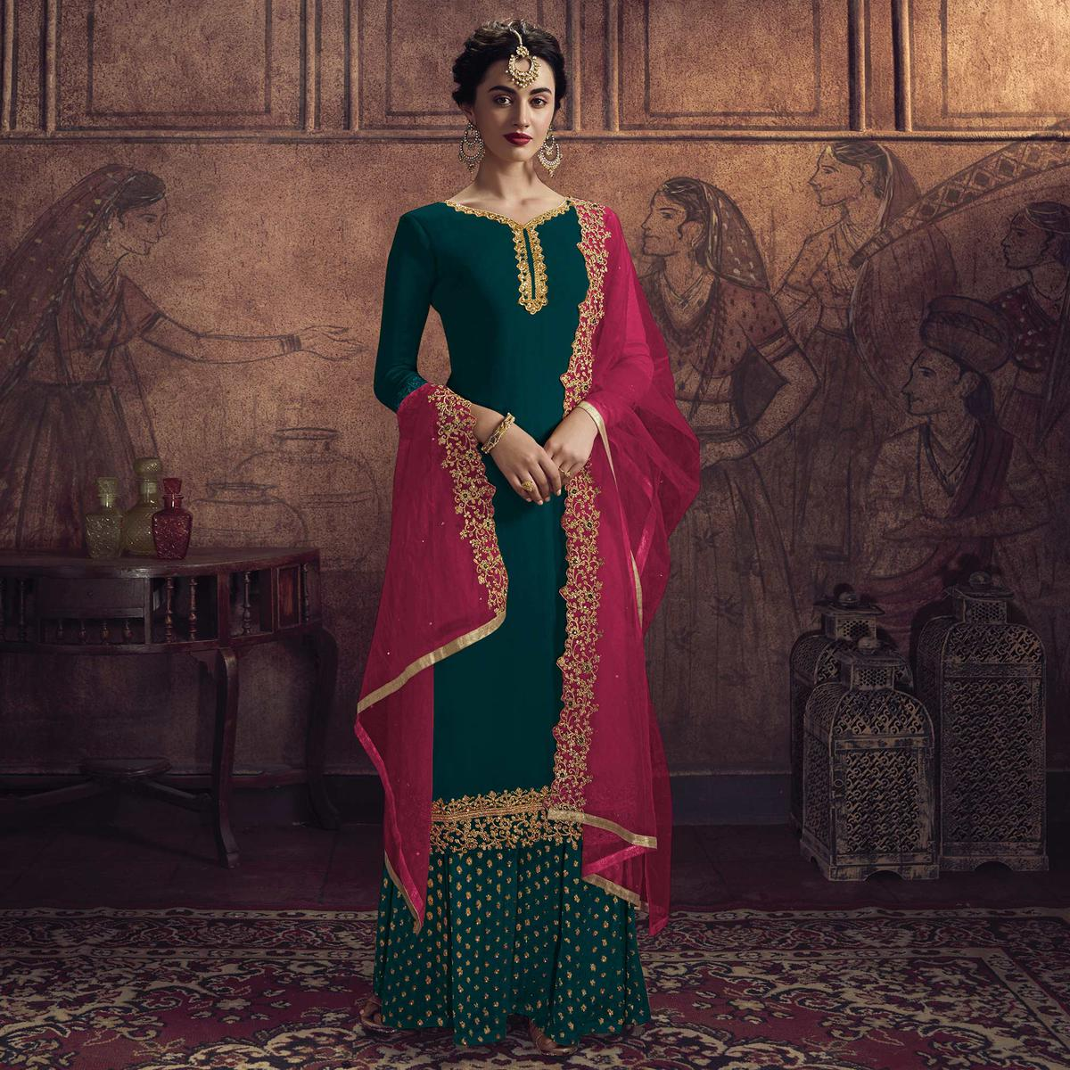 Capricious Green Colored Partywear Embroidered Heavy Vichitra Georgette Palazzo Suit