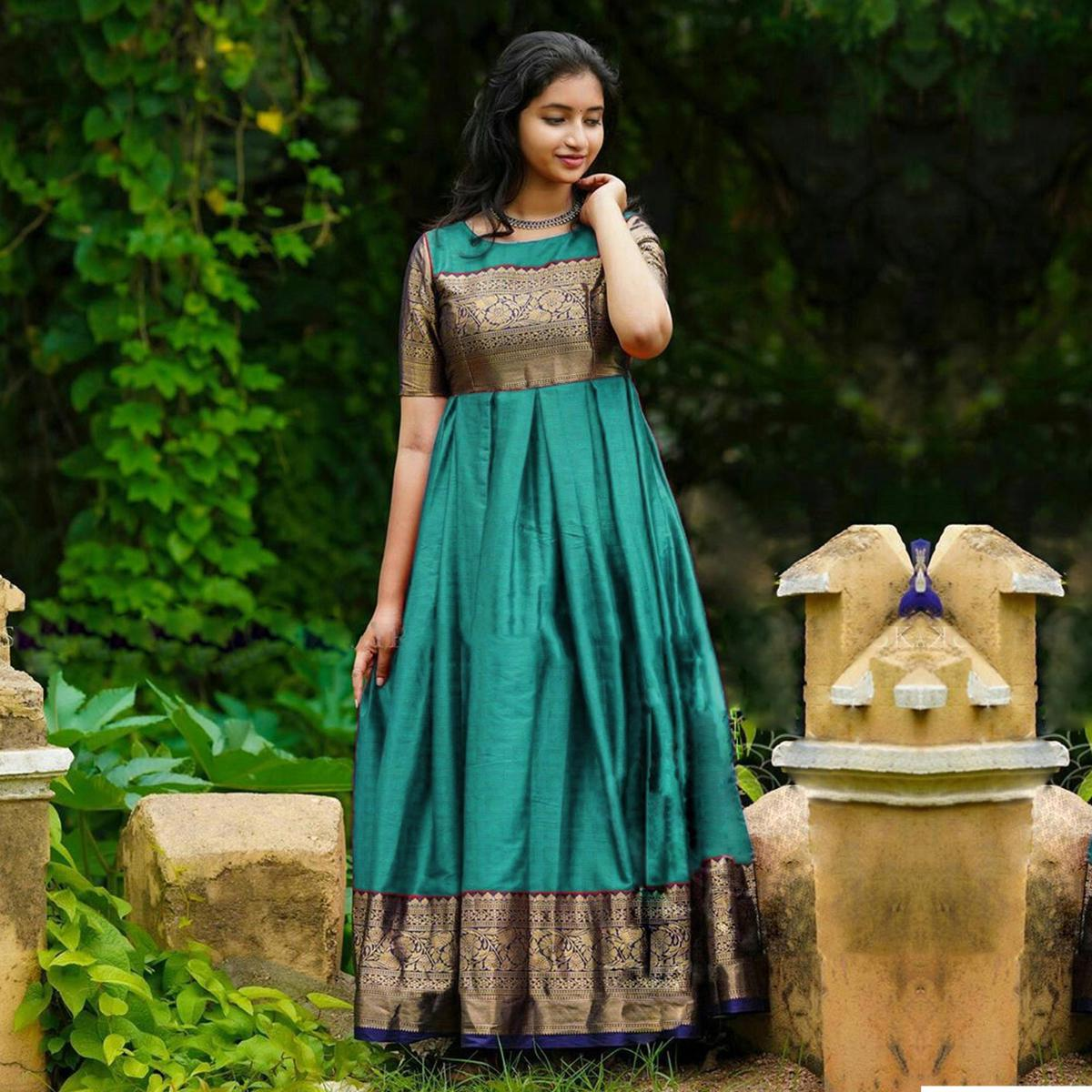 Arresting Rama Green Colored Partywear Woven Soft Silk Jacquard Gown