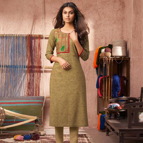 Blooming Beige Colored Partywear Embroidered Pure Cotton Kurti