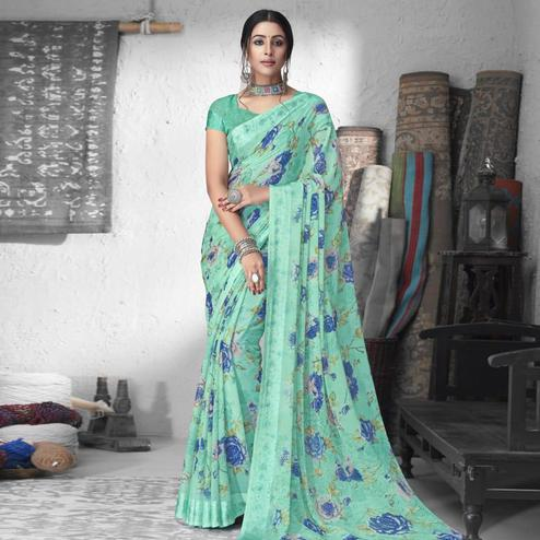 Eye-catching Sea Green Colored Partywear Floral Printed Chiffon Saree