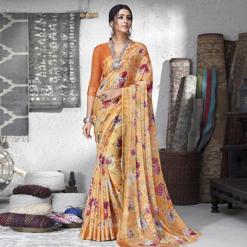 Fantastic Peach Colored Partywear Floral Printed Chiffon Saree