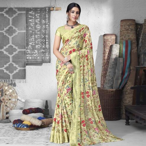 Amazing Beige Colored Partywear Floral Printed Chiffon Saree