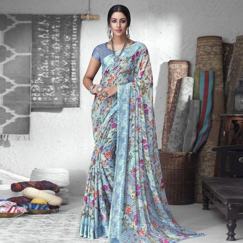 Gorgeous Light Blue Colored Partywear Floral Printed Chiffon Saree