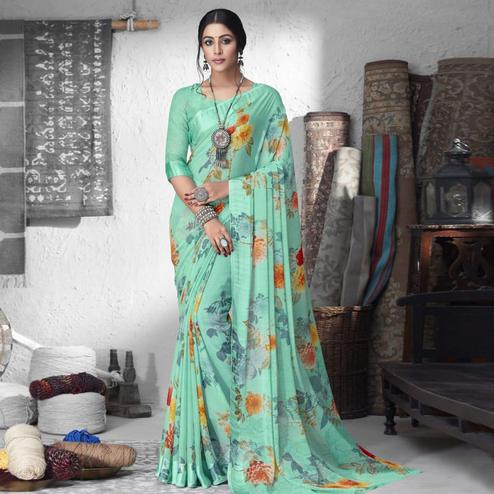 Imposing Turquoise Green Colored Partywear Floral Printed Chiffon Saree
