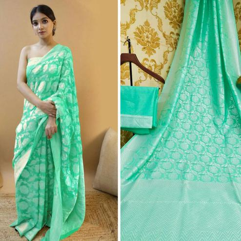 Demanding Green Colored Festive Wear Woven Soft Lichi Silk Saree
