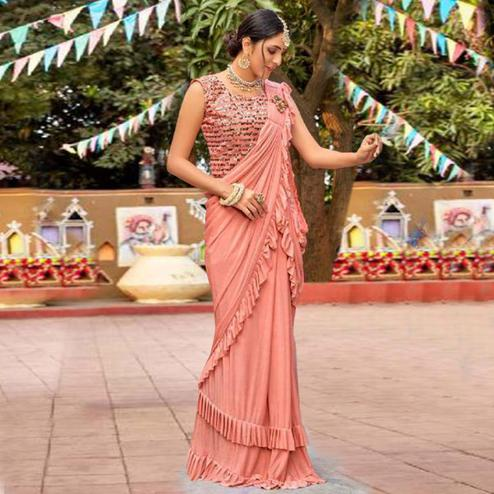 Engrossing Peach Colored Partywear Embroidered Solid Lycra Saree With Ruffel