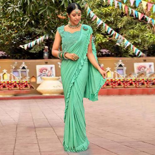 Eye-catching Pista Green Colored Partywear Embroidered Solid Lycra Saree With Ruffel