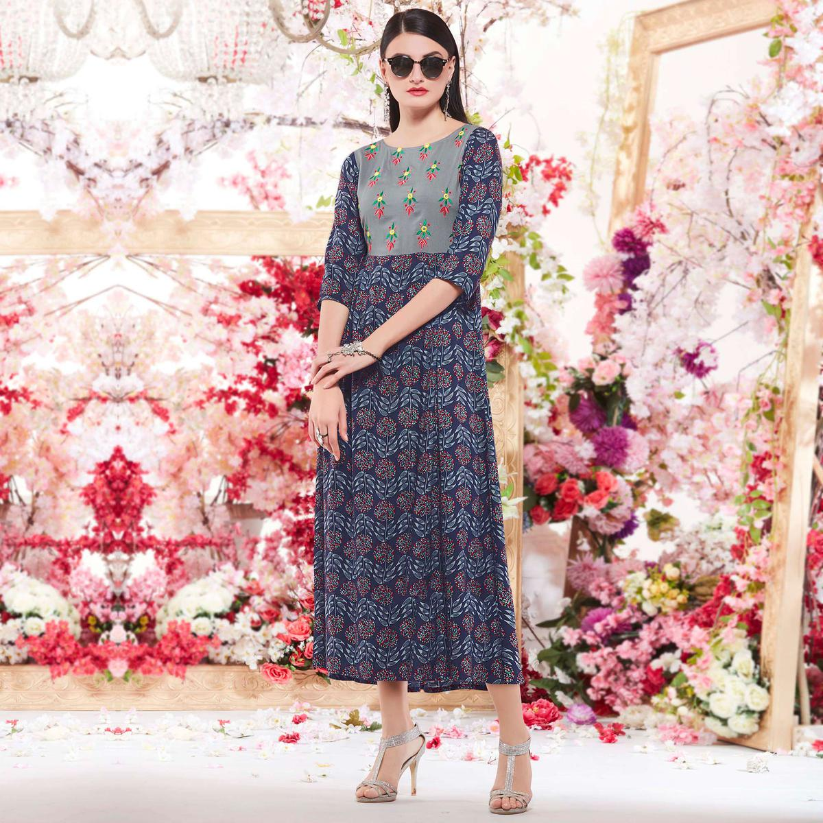 Charming Navy Blue Designer Casual Wear Printed And Embroidered Rayon Kurti