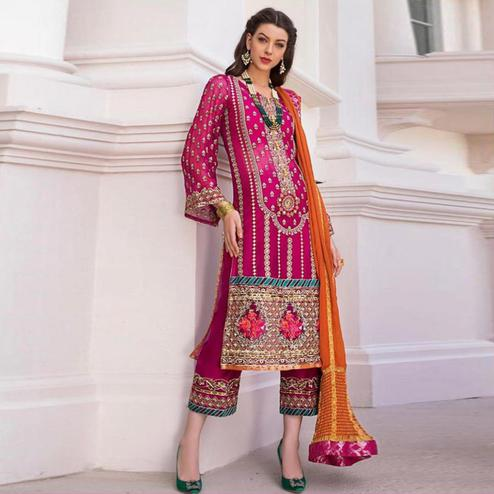 Charming Pink Colored Partywear Embroidered Heavy Georgette Suit