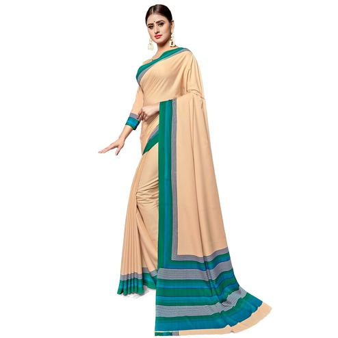 Sophisticated Light Beige Colored Casual Wear Printed Crepe Saree
