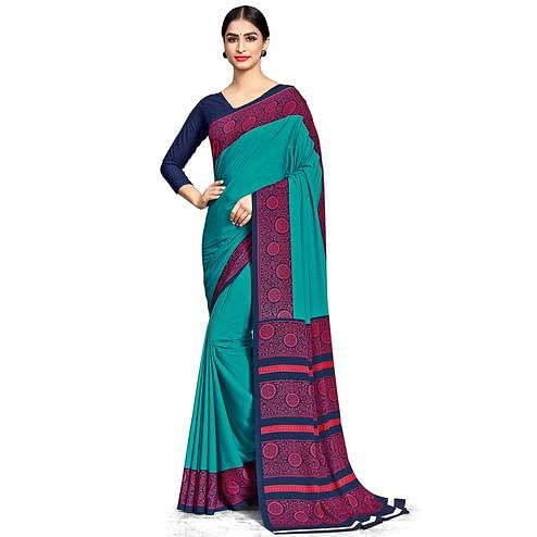 Opulent Turquoise Green Colored Casual Wear Printed Crepe Saree