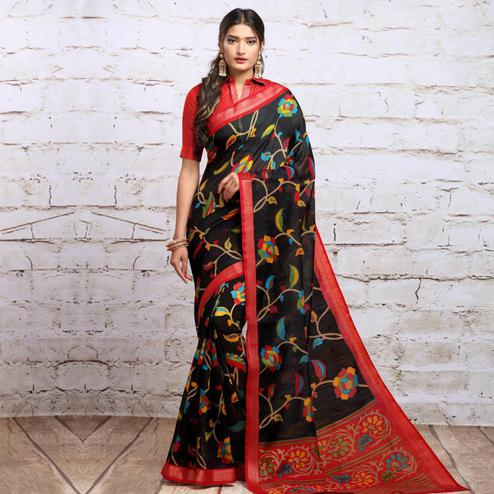 Gleaming Black Colored Partywear Floral Printed Cotton Silk Saree