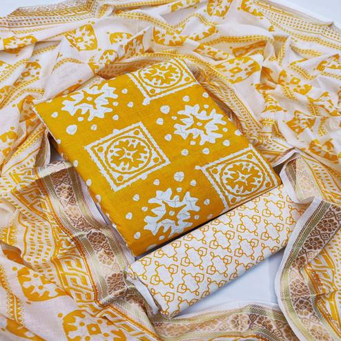 Amazing Yellow Colored Casual Wear Wax Printed Pure Cotton Dress Material