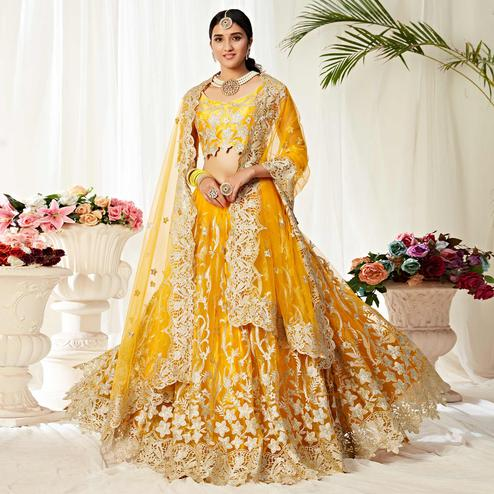 Impressive Yellow Colored Wedding Wear Embroidered Heavy Net Lehenga Choli