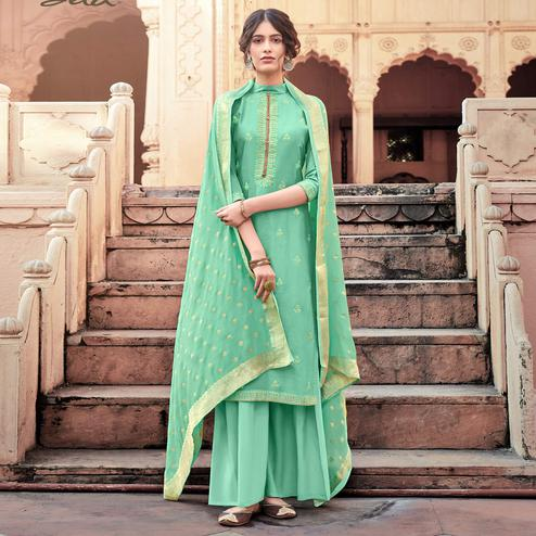 Exotic Green Colored Partywear Embroidered Viscose Muslin Palazzo Suit