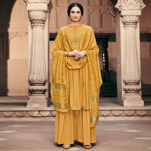 Adorning Yellow Colored Partywear Embroidered Viscose Muslin Palazzo Suit