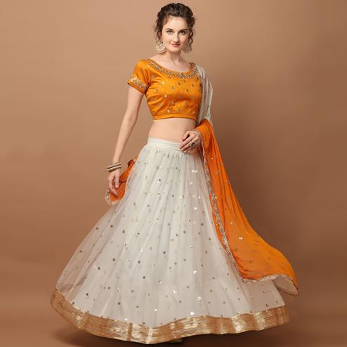 Marvellous Offwhite - Orange Colored Partywear Sequence Work Netted Lehenga Choli